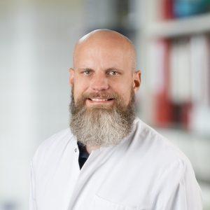 Dr. med. J. Falk